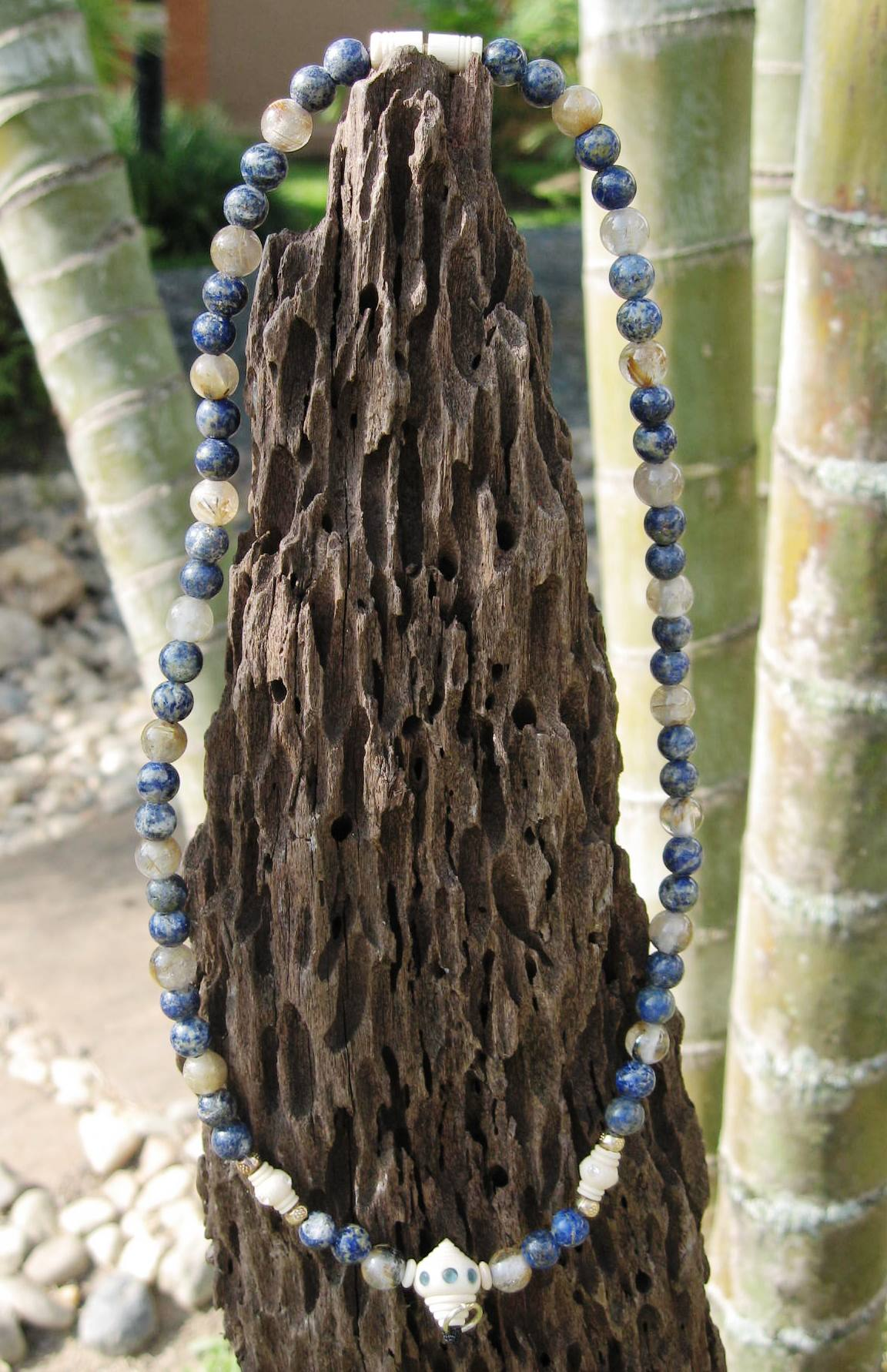Lapis stone with ivory amulet chain