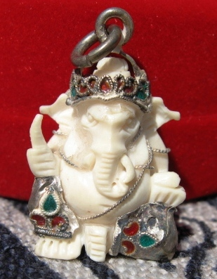 carved antique ivory Ganesha with enameled silver