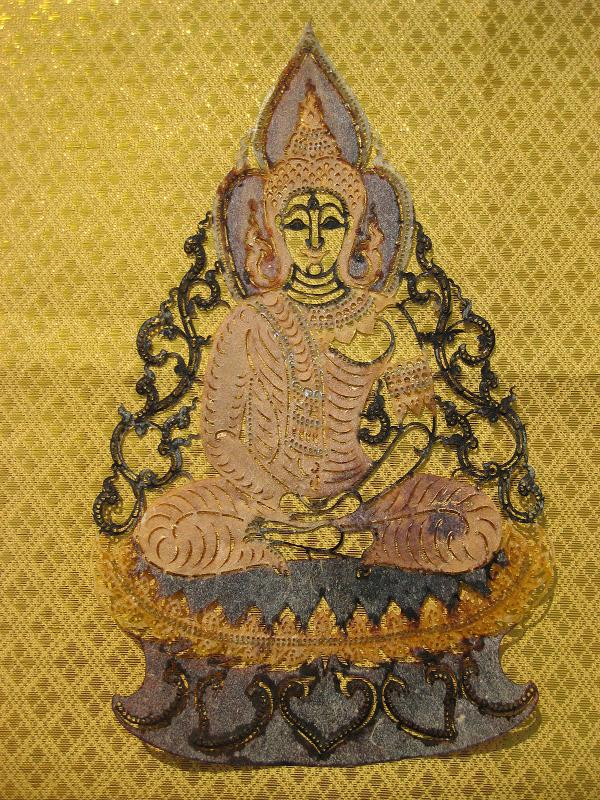Hand carved ta lung leather buddha on lotus